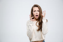 Scared woman looking at camera Royalty Free Stock Photography