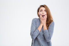 Scared woman looking at camera Stock Images
