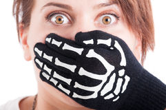 Scared woman with mouth covered by hand Royalty Free Stock Image