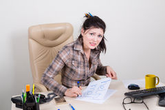 Scared woman in office looking for help Royalty Free Stock Photography