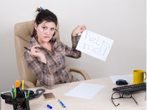 Scared woman in office looking for help Stock Photography