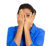Scared woman peeking Royalty Free Stock Images