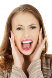 Scared woman screaming. Beautiful casual scared woman screaming Royalty Free Stock Photo