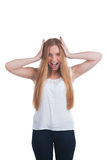 Scared woman screaming. With hands on the head isolated on white background Royalty Free Stock Photography