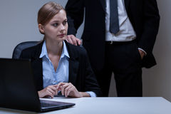 Scared woman and self-confident boss. View of scared women and self-confident boss Royalty Free Stock Photos