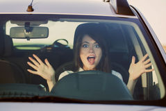 Scared woman shouts driving the car. The scared woman shouts driving the car royalty free stock images