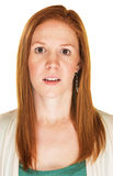 Scared Woman Staring. Young adult female with red hair staring Royalty Free Stock Images