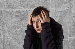 Scared woman with a strong depression. Stock Image