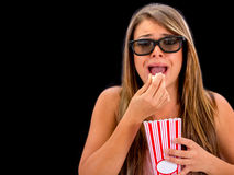 Scared woman watching 3D movie Stock Photography