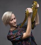 Scared woman and yellow anaconda Stock Photos
