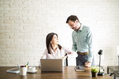 Abusive boss harassing a coworker Royalty Free Stock Photography
