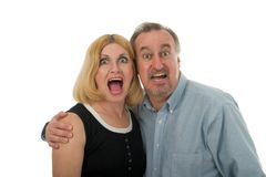 Scared Yelling Screaming Couple. Yelling and screaming couple with husband protecting wife shown by their excited expressions Stock Photo