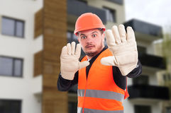 Scared young architect doing stop gesture Royalty Free Stock Images