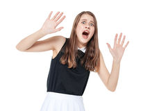 Scared young beautiful teenage girl screaming isolated. On white background Stock Photos