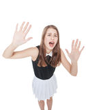 Scared young beautiful teenage girl screaming isolated Stock Photo
