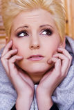 Scared young blonde. Woman portrait expressing afraid or worry Stock Photos