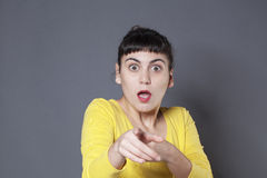 Scared young brunette recognizing someone Stock Photos
