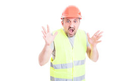 Scared young builder screaming and looking terrified Stock Photography