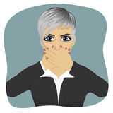 Scared young business woman covering her mouth with her hands Royalty Free Stock Image