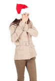 Scared young girl in red Christmas hat Stock Photography