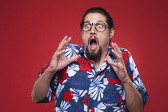 Scared young man in Hawaiian shirt looking away Royalty Free Stock Photography