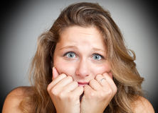 Scared young woman Stock Photography