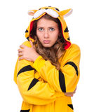 Scared young woman dressed as a tiger Stock Image
