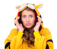 Scared young woman dressed as a tiger Stock Images