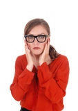 Scared young woman with glasses. Stock Photos