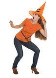 Scared young woman in Halloween hat stock photos