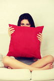 Scared young woman is waching tv. Royalty Free Stock Photo