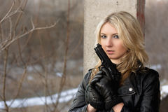 Scared young woman with a weapon Royalty Free Stock Photo