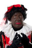 Scared Zwarte piet ( black pete) typical Dutch. Character part of a traditional event celebrating the birthday of  Sinterklaas in december over white background Royalty Free Stock Photography
