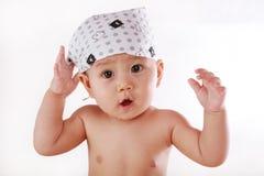 Scarf baby raised his hand Stock Photos