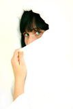 Scarf face. Woman hiding beautiful face behind scarf tissue stock photo