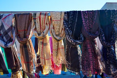 Scarf foulards in a row outdoor Stock Image