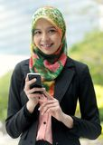 Scarf girl  using smart phone Stock Photography