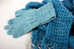Scarf and glove. Modern blue glove and scarf for woman Royalty Free Stock Photos