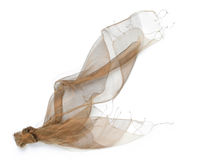 Scarf. Golden tulle scarf on white Royalty Free Stock Photography