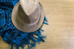 Scarf and hat on wooden Stock Image