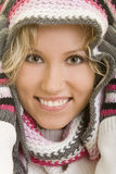 Scarf on the head. Smiling blond woman with a scarf wrapped around her head Royalty Free Stock Images