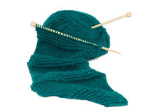 Scarf on knitting needles Royalty Free Stock Image