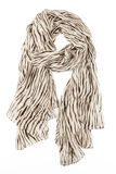 A scarf is silk beige with strakes strung on a knot. Isolated on white background Stock Photo