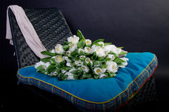 Scarf and white tulips on black chair Royalty Free Stock Photo