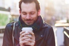 Scarfed man enjoying warm beverage Stock Photography