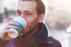 Scarfed man enjoying warm beverage Royalty Free Stock Images
