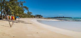 Scarfs drying on a beach. In Madagascar Stock Photos