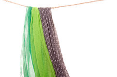 Scarfs hanging on a rope clothesline Stock Photos