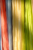Scarfs on Rack. Colorful Scarfs on Rack in sun and shade royalty free stock photos