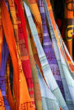 Scarfs in a variety of colors. Stock Photos